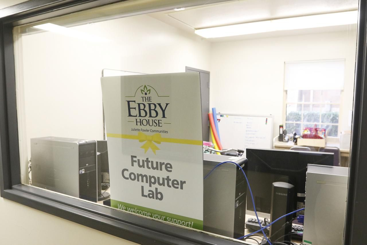 """A sign reading """"Future Computer Lab"""" sits in a window at the Ebby House."""