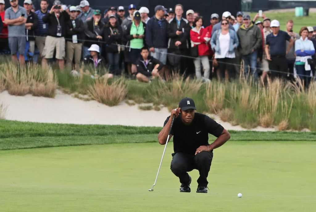 Tiger Woods lined up a putt on the 17th green during the second round of the PGA Championship in May.
