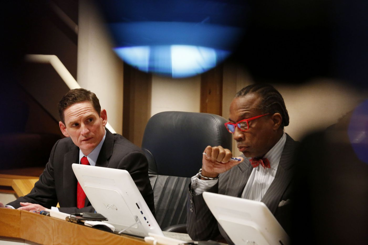 Dallas County Judge Clay Jenkins and Commissioner John Wiley Price listen during a Dallas County Commissioners Court special meeting to discuss the Ebola crisis in October, 2014.