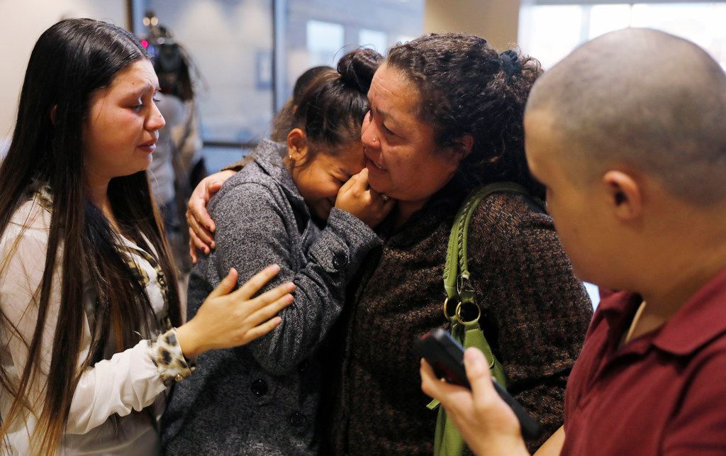 Nora Rubi, 19, from left, Ana Cartagena, 13, Jose's sister, Norma Ochoa, grandmother of Jose Cruz, and Julio Cartagena, Jose's brother, console one another after former Farmers Branch police officer Ken Johnson was sentenced to 10 years in prison for the murder of Jose Cruz. Photo taken on Tuesday, January 9, 2018 at the Frank Crowley Courts building.