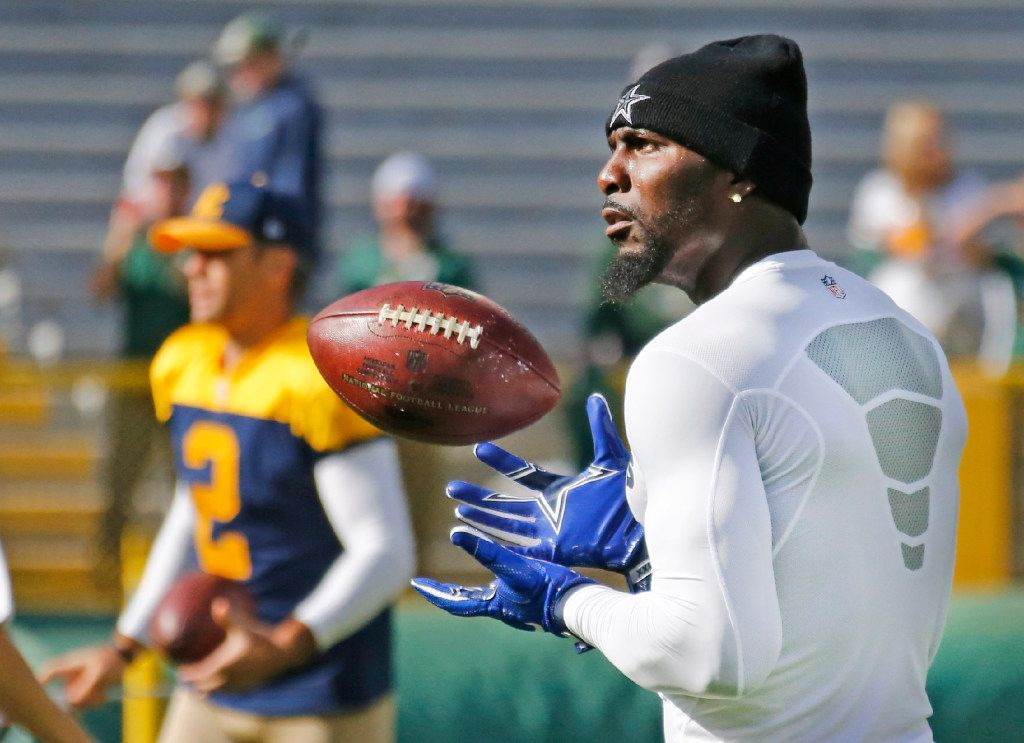 Dallas Cowboys wide receiver Dez Bryant (88) throws and catches passes  during early warmups before the Dallas Cowboys vs. the Green Bay Packers NFL football game at Lambeau Field in Green Bay, Wisconsin, on Sunday, October 16, 2016. (Louis DeLuca/The Dallas Morning News)