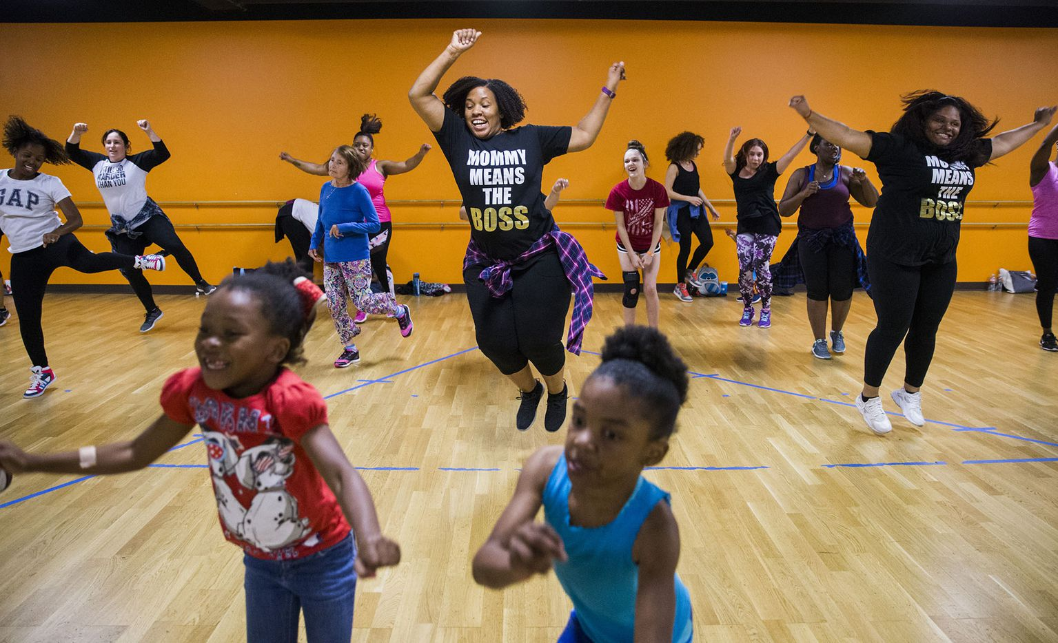 "Moms and their children participate in a ""Moms with Moves"" dance class on May 12 at Power House of Dance in Dallas."