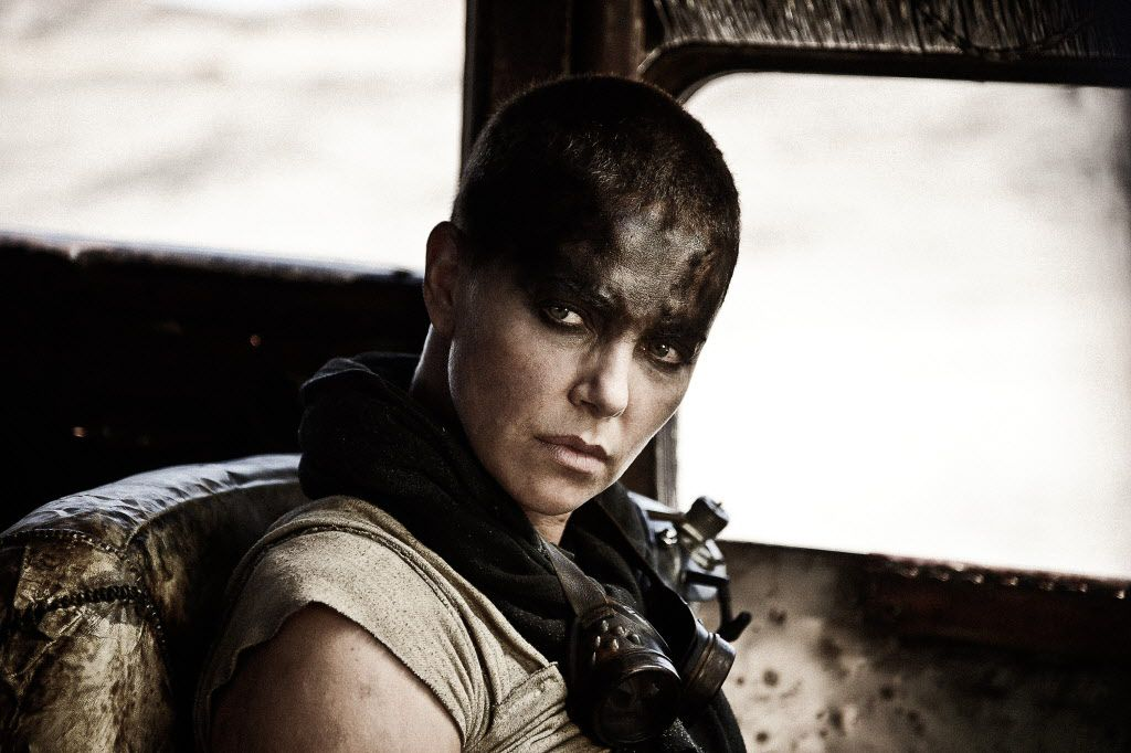 """This photo provided by Warner Bros. Pictures shows Charlize Theron as Imperator Furiosa in Warner Bros. Pictures' and Village Roadshow Pictures' action adventure film, """"Mad Max: Fury Road,"""" a Warner Bros. Pictures release."""