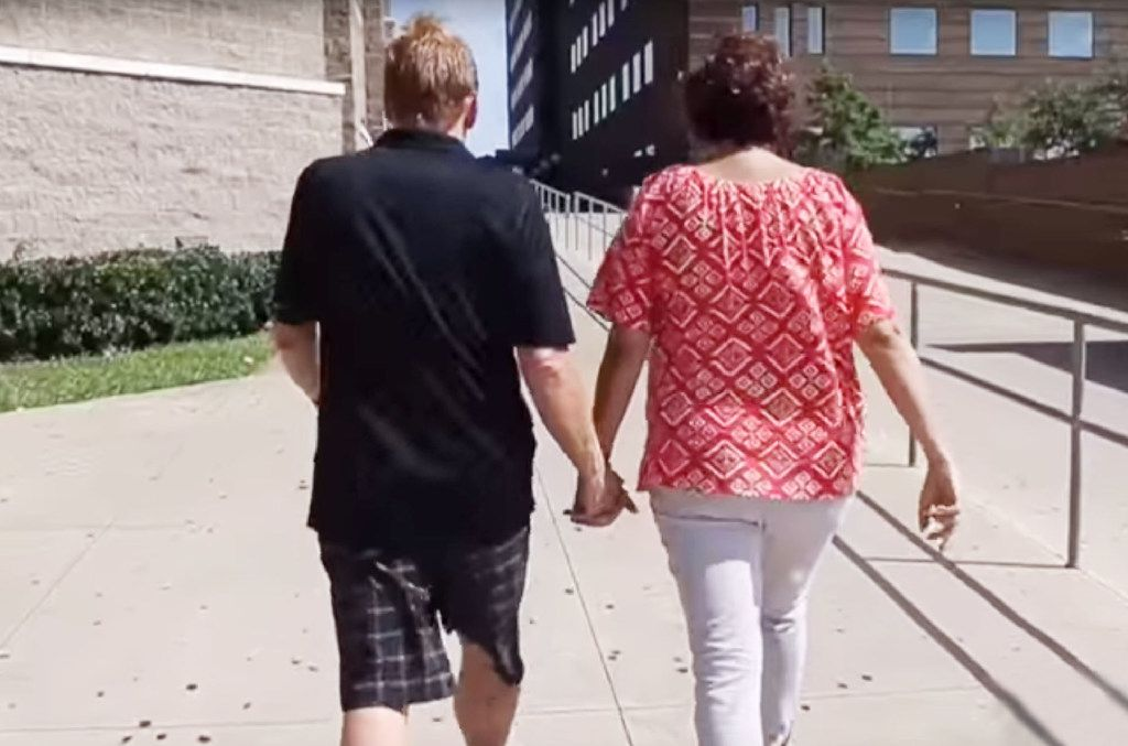 Dave and Lisa Stephenson walk into the Dallas County Jail in early July 2016 to visit Thomas Johnson. They plan to visit him again wherever he's sent to serve his life sentence.