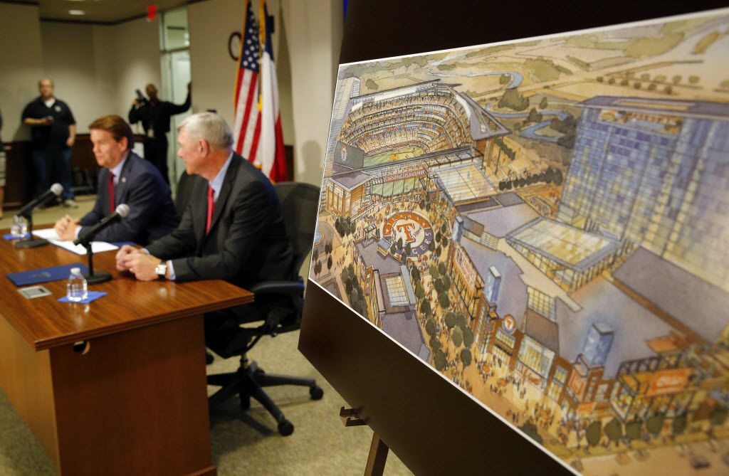 An artist rendering of the proposed ballpark and entertainment center is on display as Arlington Mayor Jeff Williams and Texas Rangers Co-Chairman Ray Davis unveil plans at a May 20 press conference at City Hall. Plans are for a new retractable-roof ballpark to be built in Lots A&B across Randol Mill Road from Globe Life Park.