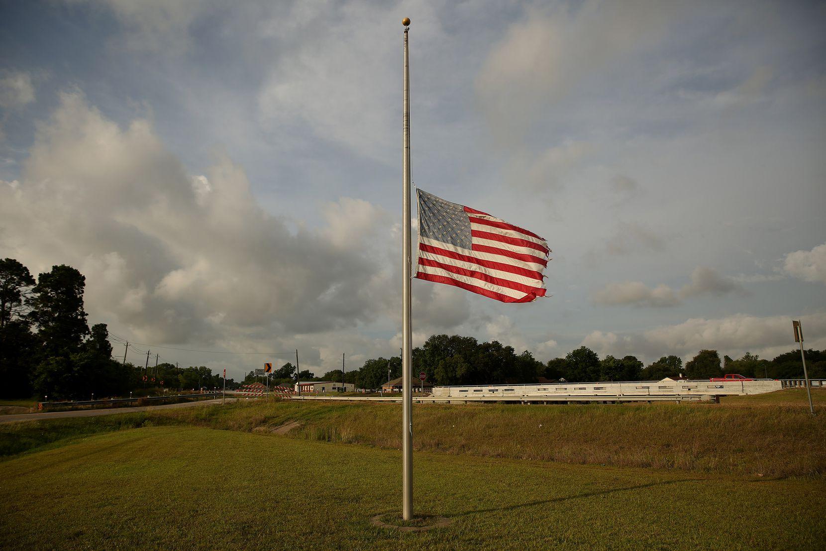 A flag flies at half staff on FM 646 in Santa Fe, Texas Sunday May 20, 2018.