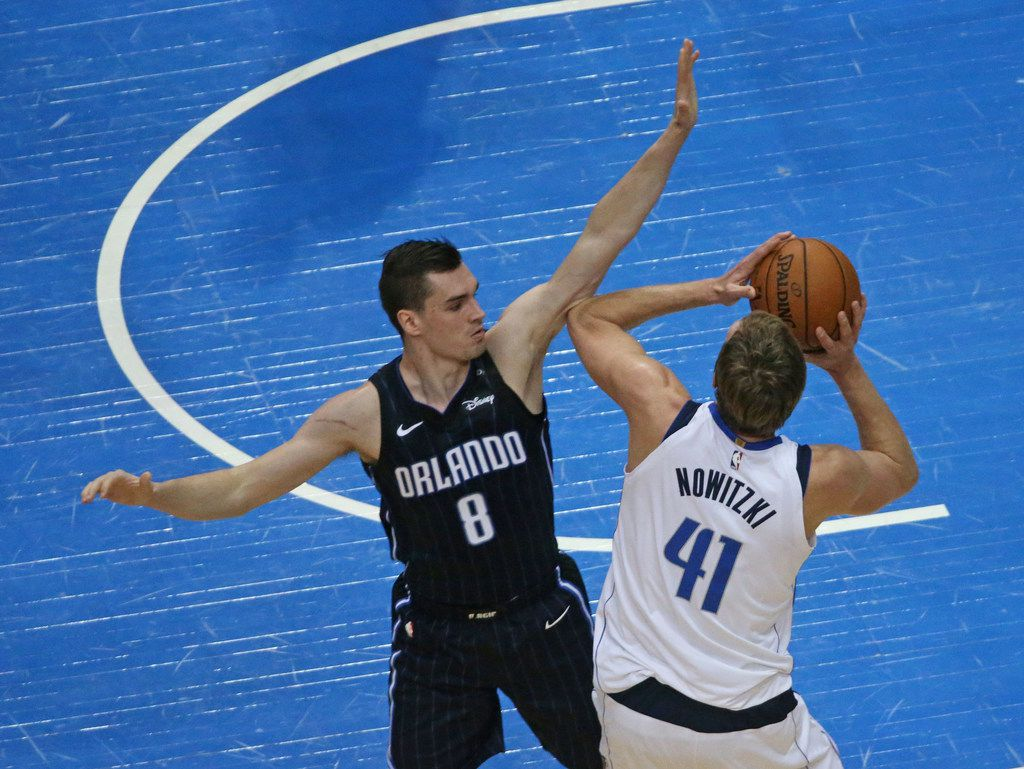 Dallas Mavericks forward Dirk Nowitzki (41) shoots over Orlando Magic guard Mario Hezonja (8) during the Orlando Magic vs. the Dallas Mavericks NBA basketball game at the American Airlines Center in Dallas on Tuesday, January 9, 2018. (Louis DeLuca/The Dallas Morning News)