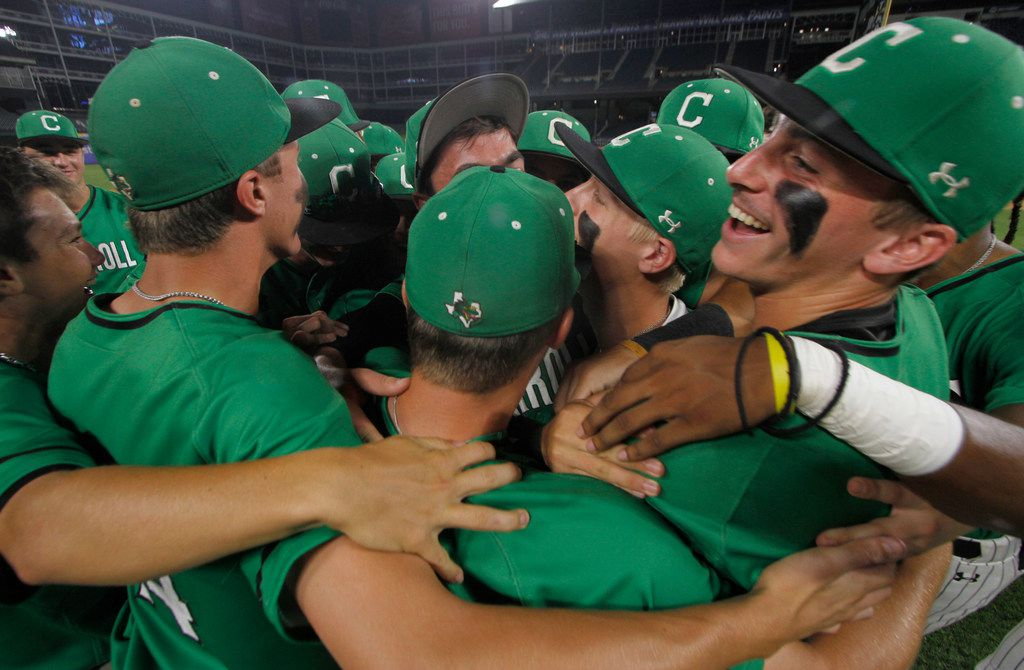 Southlake Carroll 1st baseman Grant Golomb (18), far right, was all smiles as he celebrates with teammates following the Dragon's 6-0 victory over Odessa to advance. The two teams played their one-game Class 6A Region l semifinal baseball game at Globe Life Park in Arlington on May 24, 2019. (Steve Hamm/ Special Contributor)