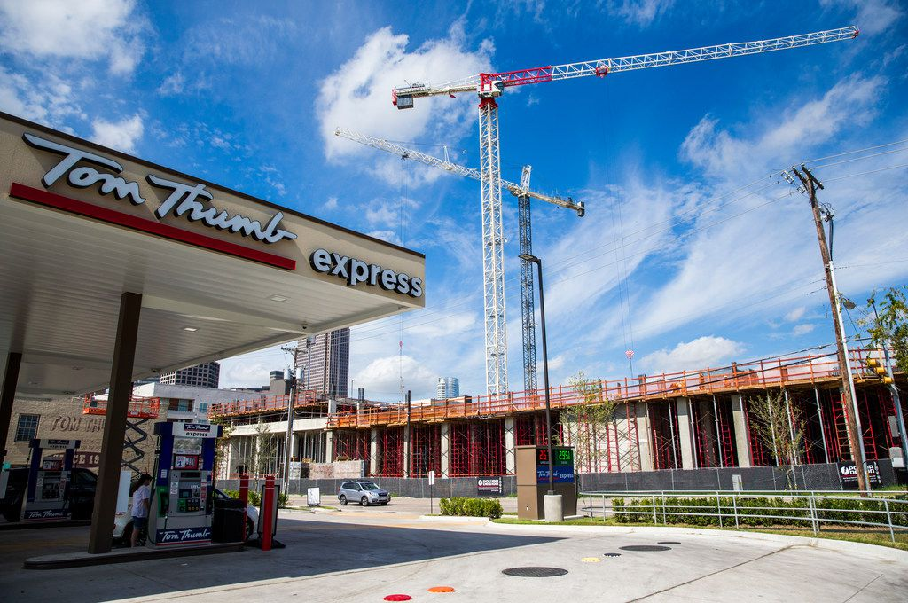 Fuel pumps at a Tom Thumb Express store on Sept. 20, 2018 at the corner of Live Oak and Texas Street in Dallas. A 10-story apartment building called The Gabriella is being built across the street, and it will feature a Tom Thumb on the street level in 2019.