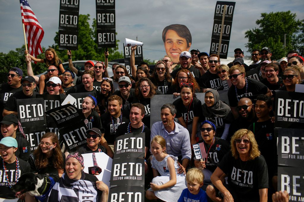 Democratic presidential candidate Beto O'Rourke posed for a photo with his campaign workers during the Fourth of July parade on in Independence, Iowa, on Thursday. Democratic candidates for president including Joe Biden, Kamala Harris, Pete Buttigieg and Bernie Sanders celebrated America's independence in Iowa.