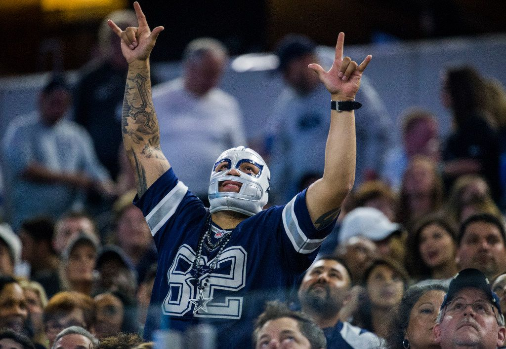 A Dallas Cowboys fan cheers during the fourth quarter of their game against the Detroit Lions on Monday, December 26, 2016 at AT&T Stadium in Arlington, Texas.