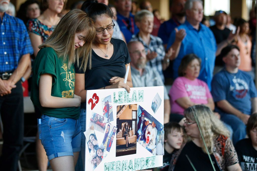 At a memorial service Sept. 1 in Odessa, high school students Celeste Lujan (left) and Yasmin Natera mourn their friend, Leilah Hernandez, one of the victims of the mass shooting Saturday.