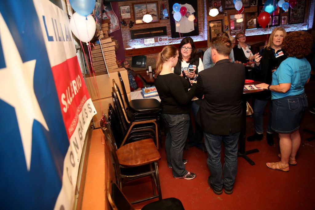 People gather in support of Lillian Salerno, a Democratic candidate headed to a runoff in Texas' 32nd Congressional District, during a watch party on March 6 at Louie's in Dallas.