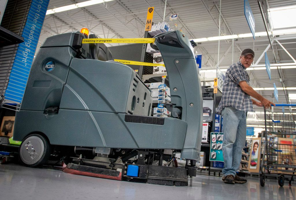 A customer watches as a robotic floor scrubber turns onto an aisle at a North Richland Hills Walmart on April 5, 2019. (Robert W. Hart/Special Contributor)