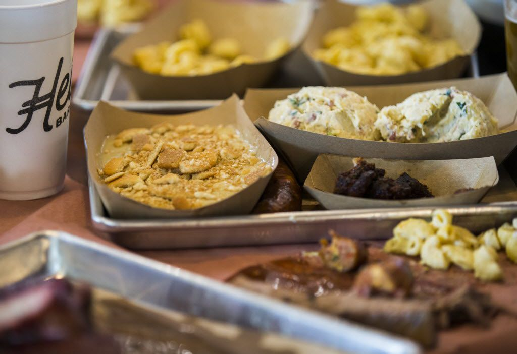 A selection of sides and meats sit on a table as Heim Barbecue opens a new location on Saturday, August 6, 2016 on W. Magnolia Ave. in Fort Worth.