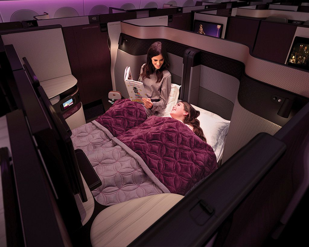 Seats in the middle section of Qsuite business class can be converted into a double bed.