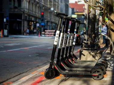 Bird scooters parked near the curb at the 1400 block of Main Street in downtown Dallas on Sunday 24 March 2019.