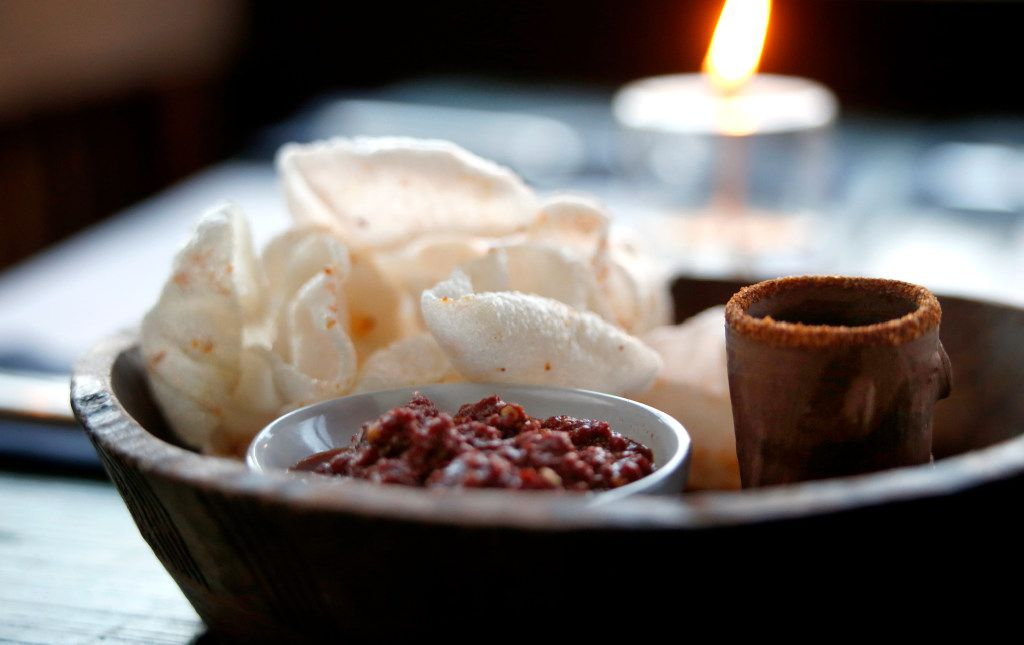 Shrimp chicharrones with salsa rojo and a cup of mescal at the Capri (Guy Reynolds/The Dallas Morning News)