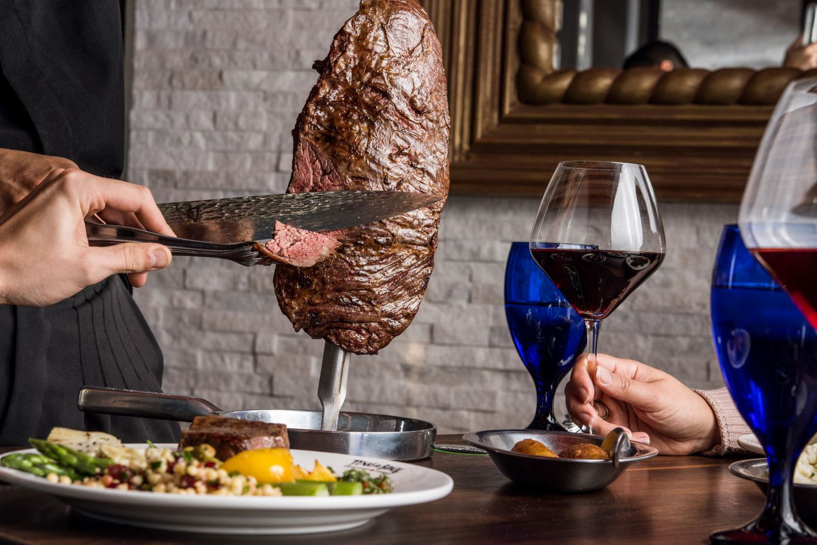 Meat is carved tableside at Texas de Brazil.