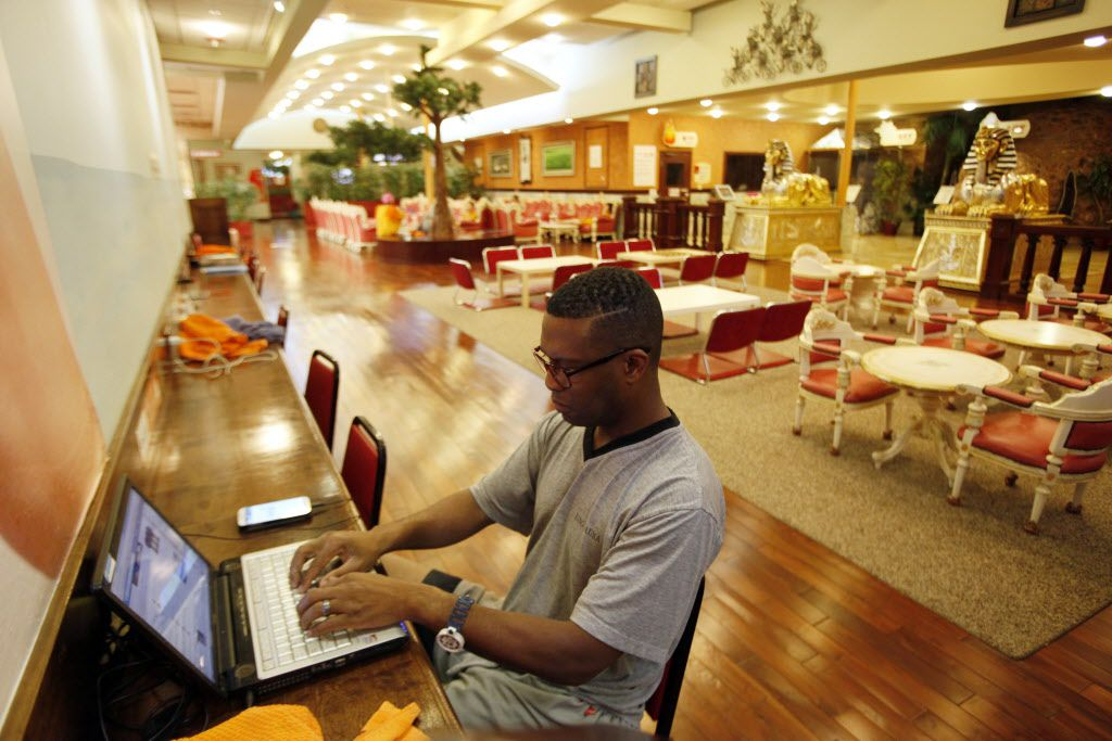 Will Horn, 45, of Arlington, uses his laptop near the food court at King Spa, on Wednesday, Oct. 06, 2015. Free Wi-Fi is  accessible throughout the King Spa complex.