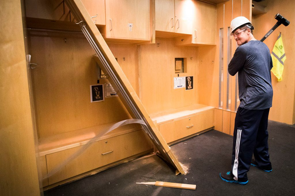 Dallas Mavericks owner Mark Cuban poses with a sledgehammer after he began the demolition process of the Mavericks locker room during a press availability before the 2017 NBA Draft at American Airlines Center on Thursday,June 22, 2017, in Dallas. The team is renovating the locker room into a state-of-the-art facility for the start of next season. (Smiley N. Pool/The Dallas Morning News)