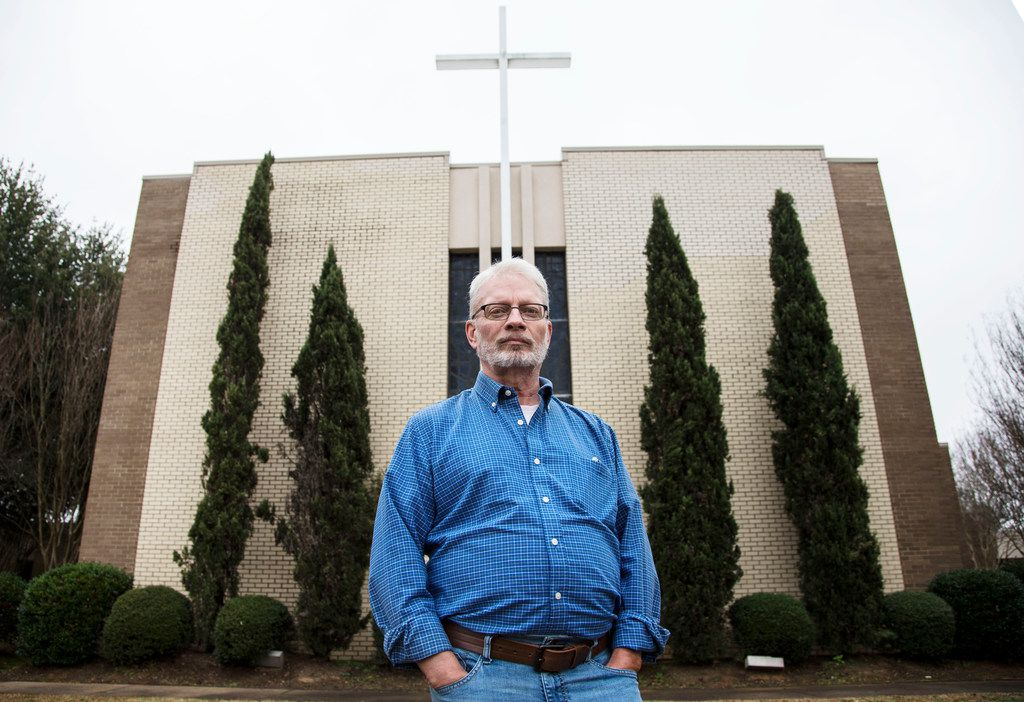 "John Smid, the former director of Memphis-based ex-gay ministry Love In Action, poses for a photograph in front of his church in Paris, Texas on Dec. 7, 2018. A character is based off him in the new movie ""Boy Erased,"" which came out in November."