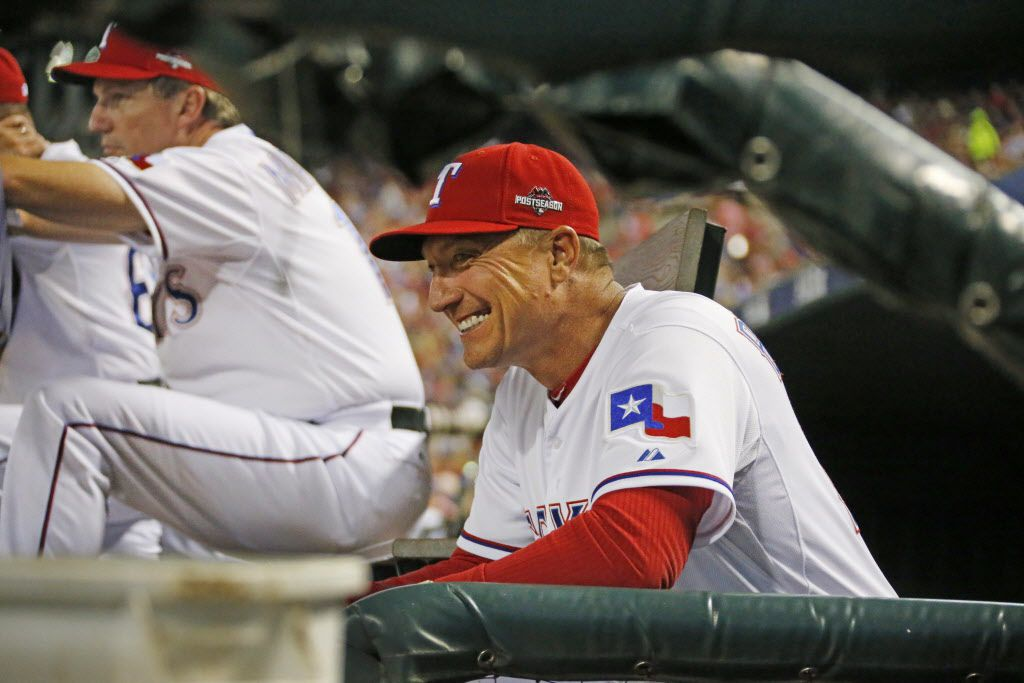 Texas Rangers manager Jeff Banister (28) sneaks a quick smile late in the game during Game 3 of the ALDS between the Texas Rangers and the Toronto Blue Jays at Globe Life Park in Arlington, Texas on Sunday, October 11, 2015. (Louis DeLuca/The Dallas Morning News)