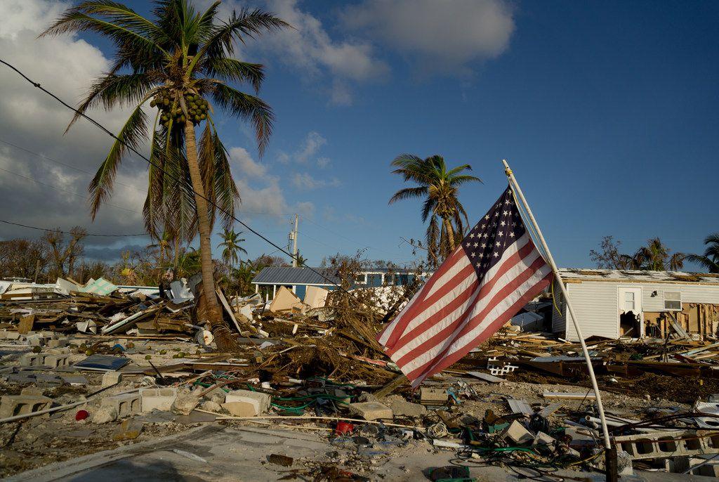 An American flag flies amid the destruction of the Sea Breeze trailer park in Plantation Key on Saturday in Marathon, Fla.