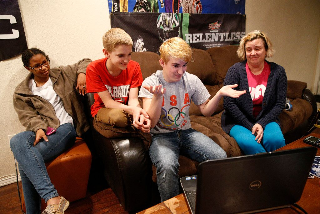 Mack Beggs (hands up) state wrestling champion and 17-year-old transgender student from Euless Trinity during an interview on Skype with his friend, D'Shaylyn August, 17, brother, Harley McNew, 13, and mother Angela McNew, at his home in Hurst, Texas, on February 28, 2017.  (Nathan Hunsinger/The Dallas Morning News)