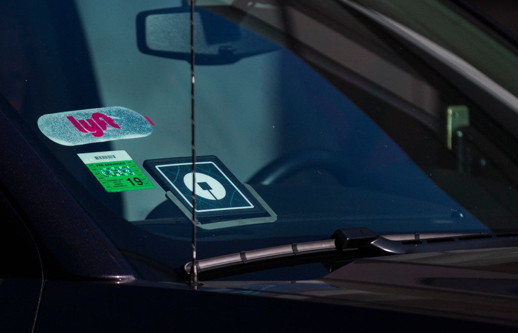 Lyft and Uber drivers pick up travelers at Dallas Love Field.