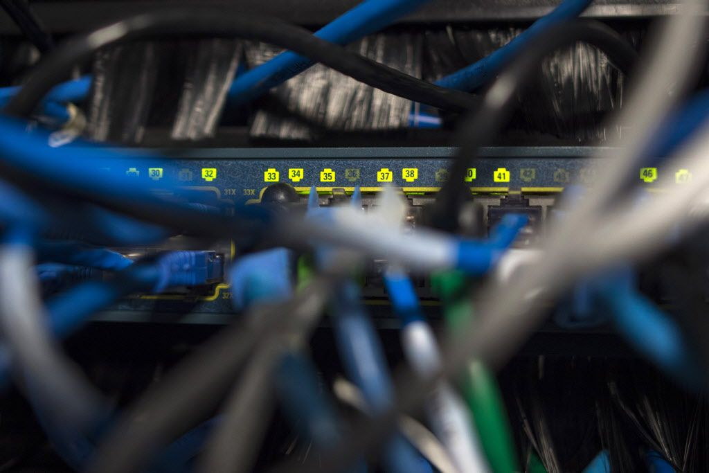 Network cables are seen going into a server in an office building in Washington, D.C., on May 13.  International investigators hunted on May 13 for those behind an unprecedented cyberattack that affected systems in dozens of countries, including at banks, hospitals and government agencies, as security experts sought to contain the fallout.