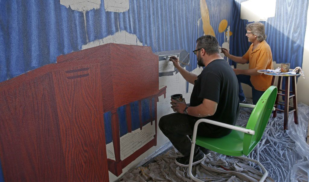 Artists Isaac Brown, left, and Dan Holzschuh work on a mural at Rock & Brews in The Colony, Texas, Tuesday, March 8, 2016. (Jae S. Lee/The Dallas Morning News)
