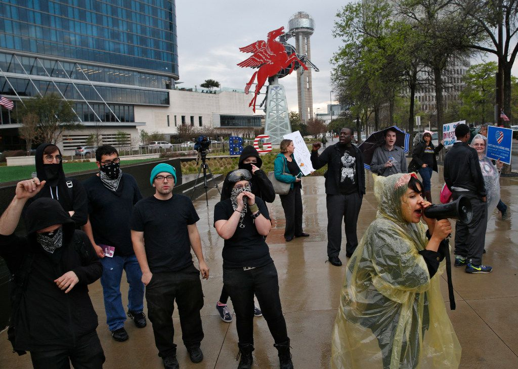 Genesis Robledo (right) with the Dallas Workers Front chants during a protest outside the Dallas County Republican Party's Reagan Day Dinner at the Omni Dallas Hotel in Dallas on March 11, 2017. (Nathan Hunsinger/The Dallas Morning News)