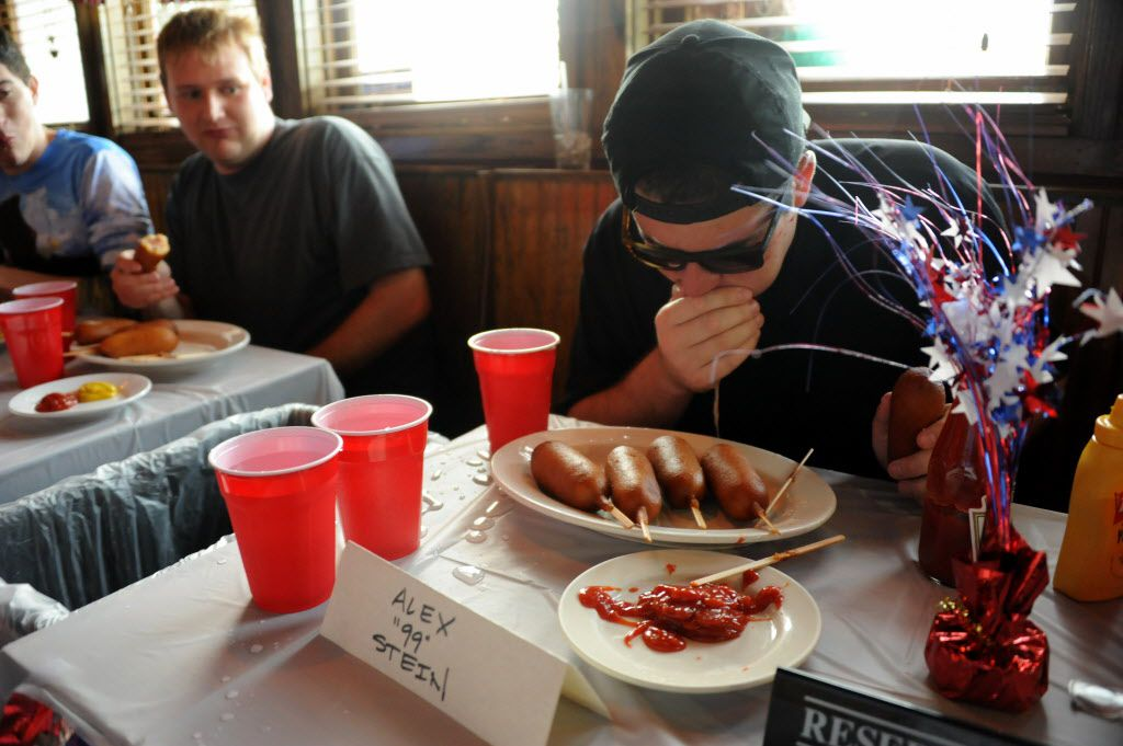Alex Stein loses it at the 7th annual Brass Knuckles Corn Dog Beatdown at The Libertine Bar on July 4, 2015.