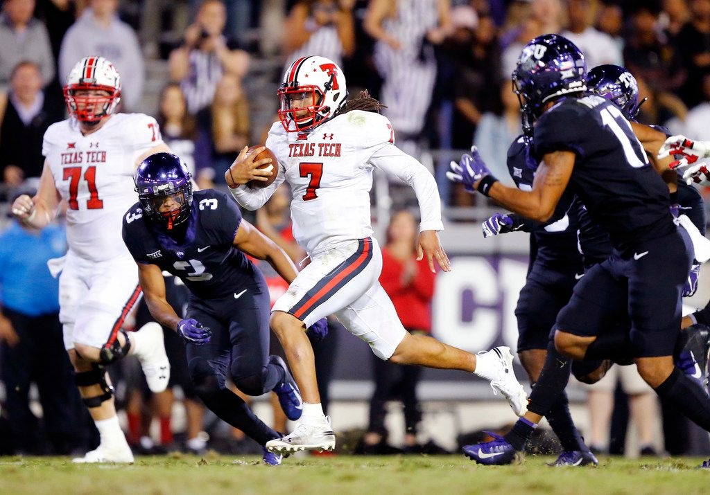 Texas Tech Red Raiders quarterback Jett Duffey (7) races down the middle of the field for a long go-ahead touchdown in the fourth quarter at Amon G. Carter Stadium in Fort Worth, Thursday, October 11, 2018. Pursuing him are TCU Horned Frogs safeties Markell Simmons (3) and Trevon Moehrig-Woodard (17). (Tom Fox/The Dallas Morning News)