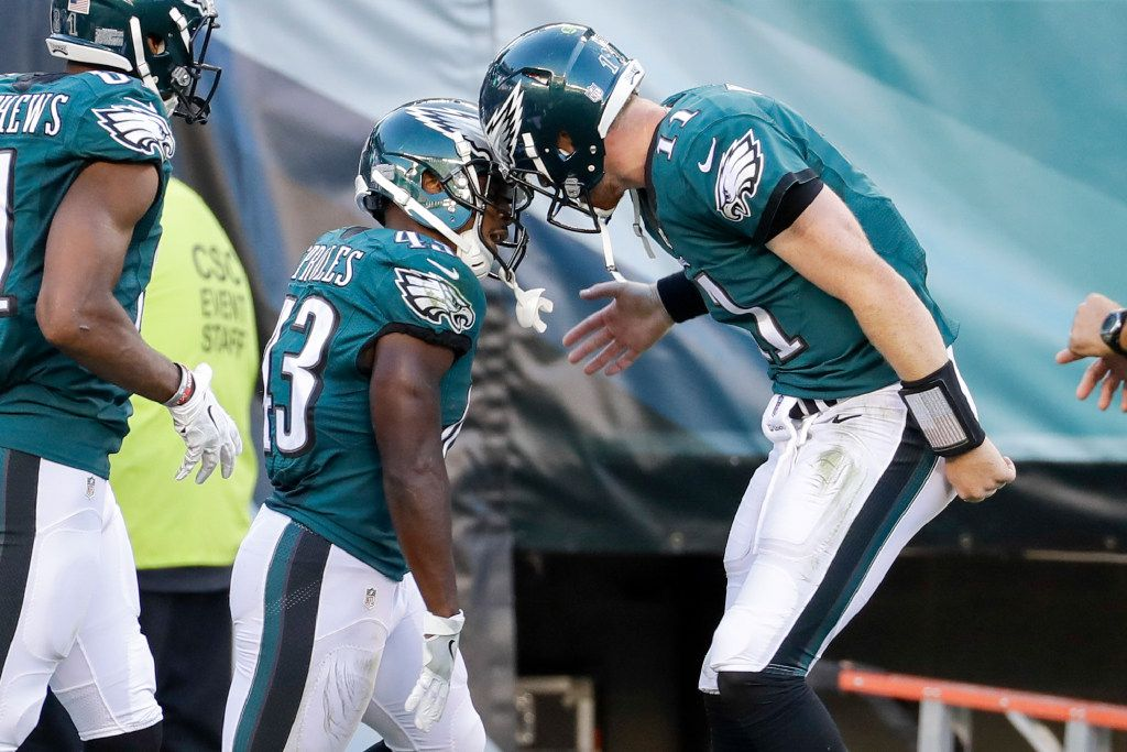 Philadelphia Eagles running back Darren Sproles (43) reacts to his touchdown with quarterback Carson Wentz (11) during the second half of the NFL football game against the Pittsburgh Steelers, Sunday, Sept. 25, 2016, in Philadelphia. The Eagles won 34-3. (AP Photo/Chris Szagola)