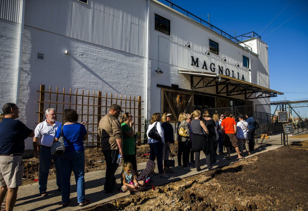 Customers line up outside the new location of Magnolia Market at the Silos, owned by Chip and Joanna Gaines, hosts of HGTV's Fixer Upper, on Thursday, October 29, 2015 at Magnolia Market at the Silos in Waco, Texas.   (Ashley Landis/The Dallas Morning News)