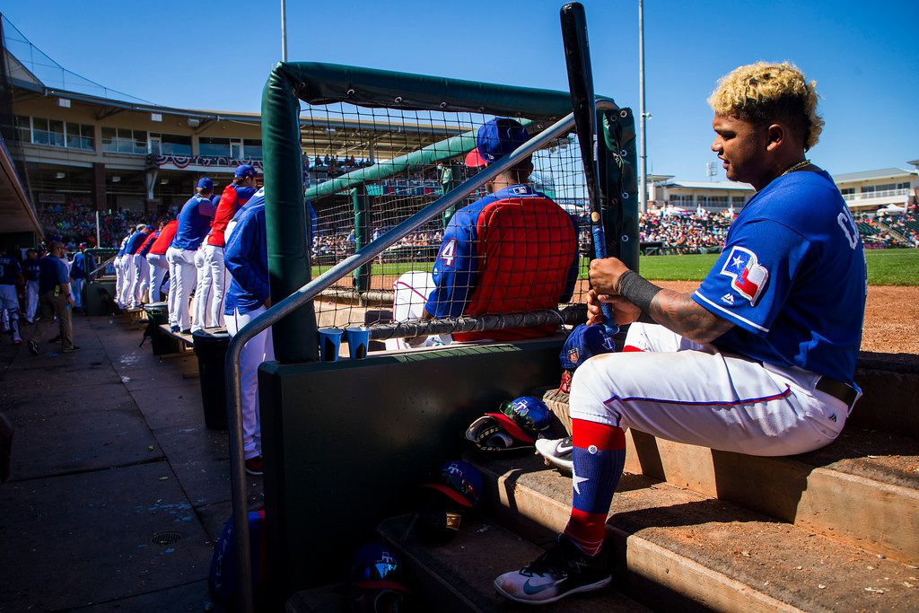 Rangers outfielder Willie Calhoun sits in the dugout before hitting in the fourth inning of a spring training game against the San Francisco Giants on Monday, March 5, 2018, in Surprise, Ariz. (Smiley N. Pool/The Dallas Morning News)