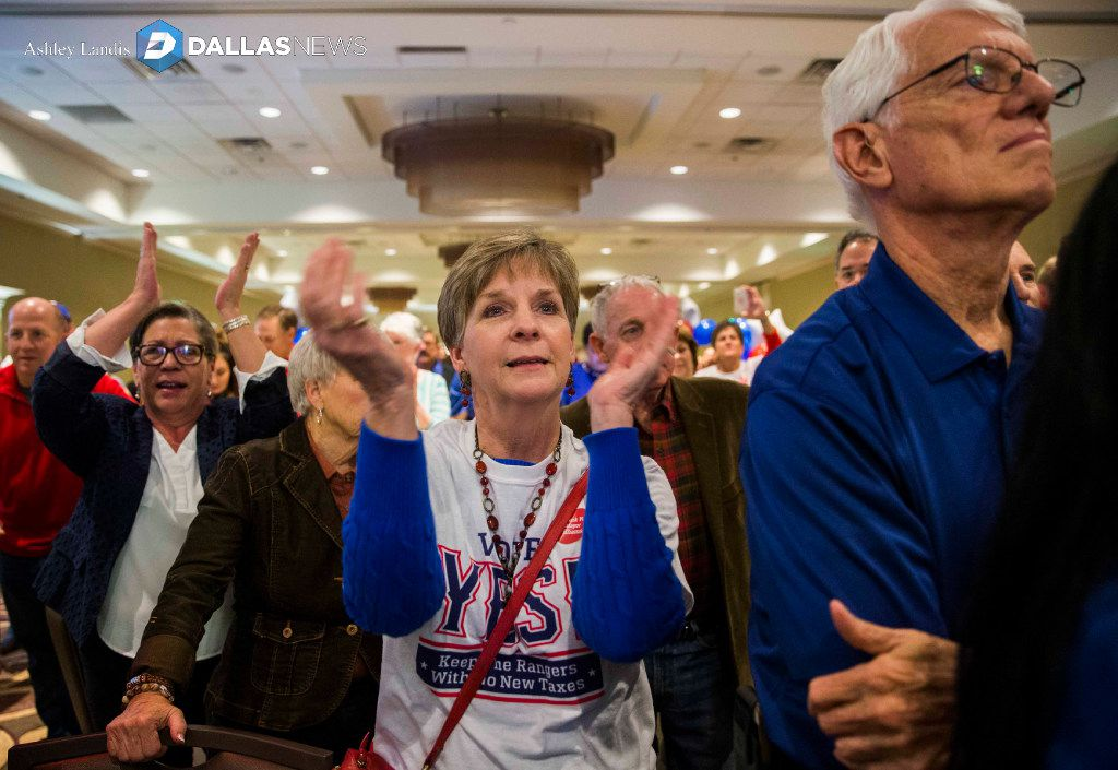 Debbie Bertrand applauds at the Hilton Arlington as supporters of a new stadium for the Rangers celebrate after polling results showed the proposition passing by a wide margin. (Ashley Landis/Staff Photographer)