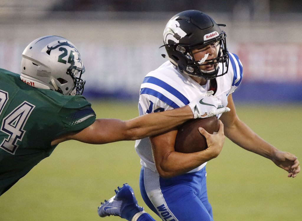 Plano West High School quarterback Andrew Picco (14) tries to evade Reedy High School defensive lineman Brooks Griffith (24) during the first half as Reedy High School hosted Plano West High School in a non-district football game at Toyota Stadium in Frisco on Thursday, August 28, 2019. (Stewart F. House/Special Contributor)
