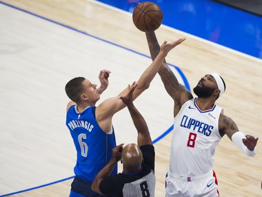 Dallas Mavericks center Kristaps Porzingis (6) goes up for the opening tipoff against LA Clippers forward Marcus Morris Sr. (8) during the first quarter of an NBA playoff basketball game at the American Airlines Center on Friday, June 4, 2021, in Dallas.