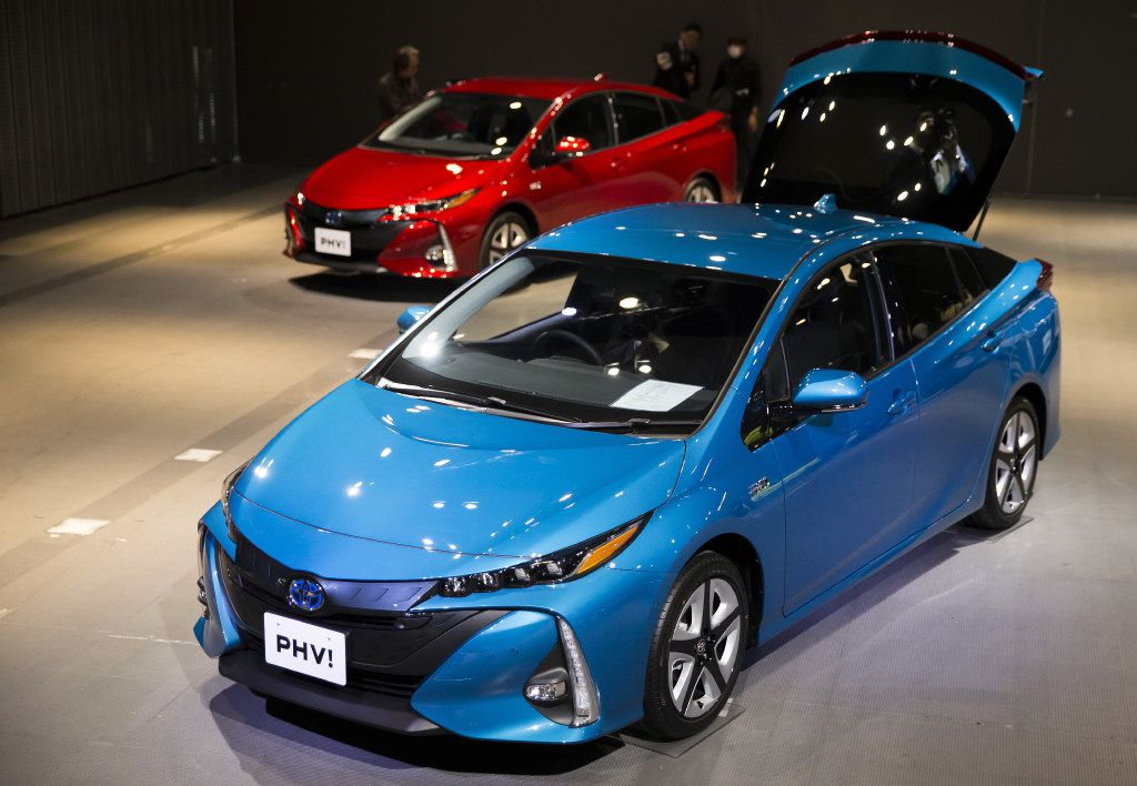 Toyota Motor Corp.'s new Prius plug-in hybrid vehicles (PHV), known as Prius Prime in the U.S., are displayed at its sales launch at the National Museum of Emerging Science and Innovation in Tokyo. (Tomohiro Ohsumi/Bloomberg)