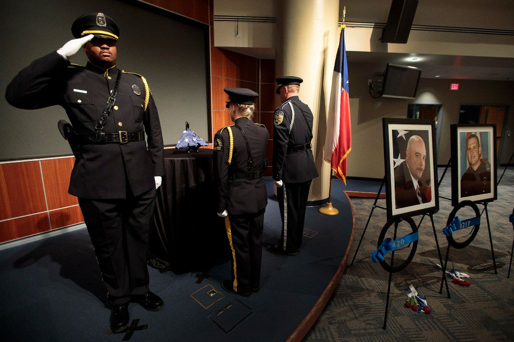 Shortly after 2 a.m. Tuesday, Dallas police Officer Londrell Tatum saluted with Senior Cpl. Natausha Crespin and DART police Officer Chris Cobb as they prepared to transfer the U.S. Honor Flag.