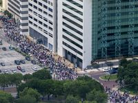 Protesters march throughout the downtown streets of Dallas during a demonstration denouncing police brutality on Saturday, May 30, 2020. The demonstration was organized in response to the recent deaths of George Floyd in Minneapolis and Breonna Taylor in Louisville.