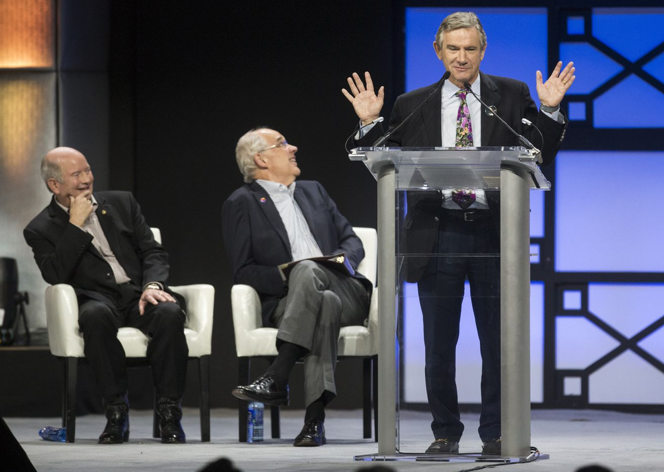 Craig Hall, right, speaks, as Southwest Airlines Presiding President Bill Cunningham, center, and Retired United States Air Force General Duncan McNabb look to the video board during a celebration of life event for Southwest Airlines Co-Founder Herb Kelleher on Tuesday, Jan. 22, 2019 at the Kay Bailey Hutchison Convention Center in Dallas.