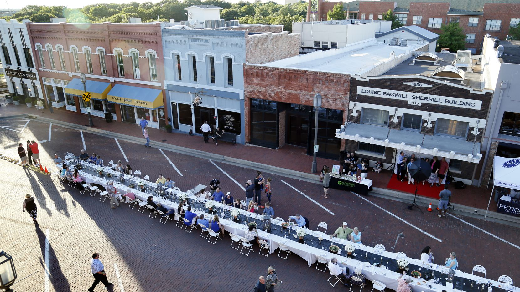 """The view of the first """"Night Out on 15th"""" on 15th Street in historic downtown Plano in 2015."""