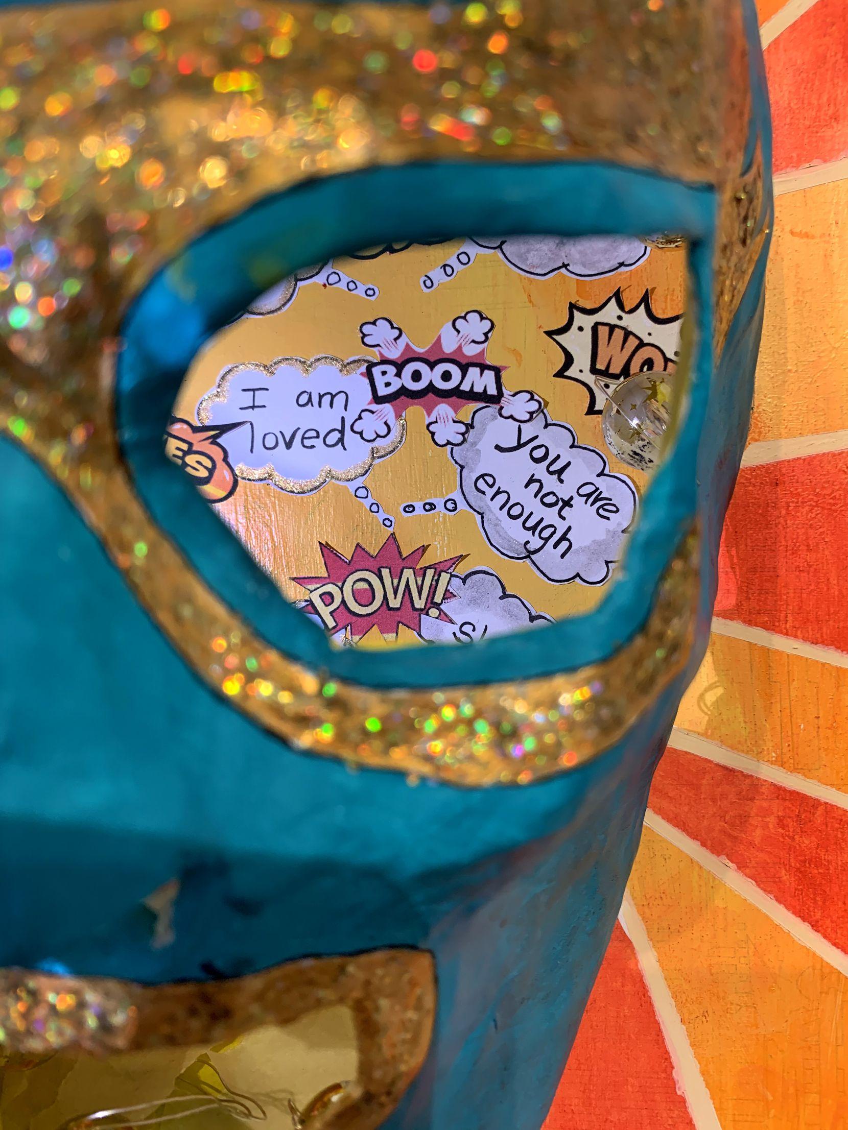 "Olga Arredondo-Brock's papier-mâché piece ""Mi Lucha"" holds hidden messages within a luchador mask."