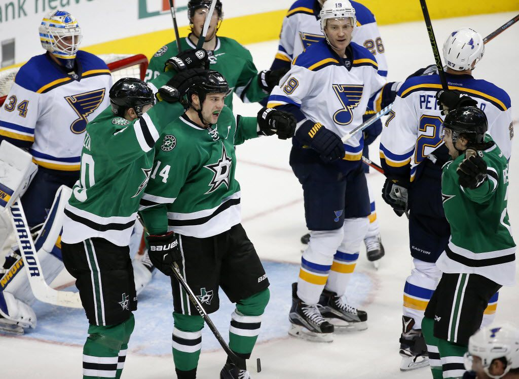 Dallas Stars left wing Jamie Benn (14) celebrates with center Jason Spezza (90) and defenseman Kris Russell (2) after he scores a goal on St. Louis Blues goalie Jake Allen (34) during the third period at American Airlines Center in Dallas, Saturday, March 12, 2016. The goal sent the game to overtime and the Stars lost 5-4 in OT. (Jae S. Lee/The Dallas Morning News)