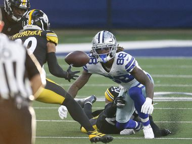 Steelers cornerback Cameron Sutton (20) forces Cowboys wide receiver CeeDee Lamb (88) to fumble as Steelers free safety Minkah Fitzpatrick (39) gathers the loose ball during the second quarter of play at AT&T Stadium in Arlington on Sunday, Nov. 8, 2020.