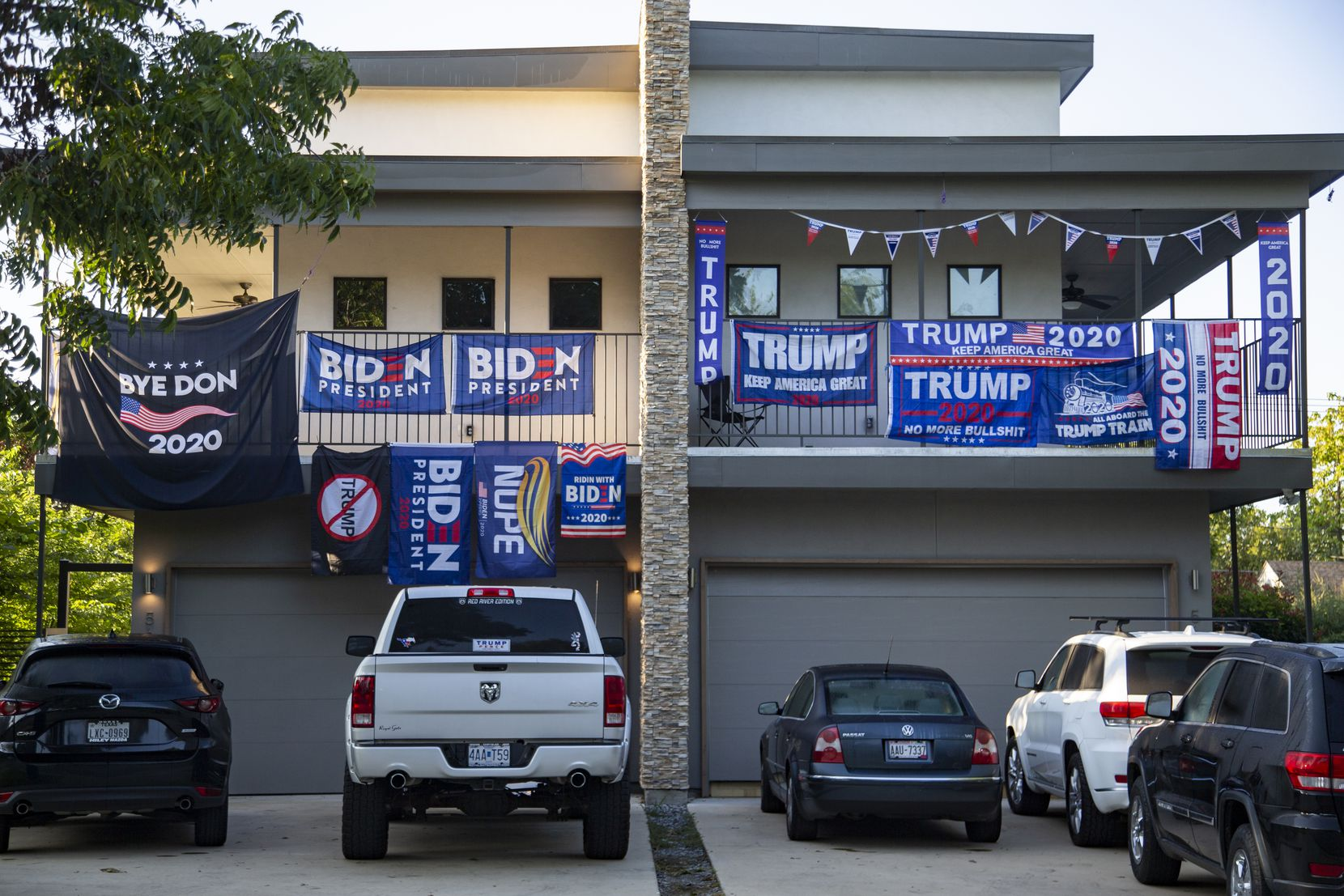 In late September, as the date for early voting to begin in Texas drew closer, apartment neighbors at the corner of Anita Street and Greenville Avenue in Dallas showed off their dueling allegiances to President Donald Trump and challenger Joe Biden.